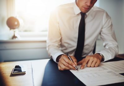 Business man or accountant lawyer working on documents